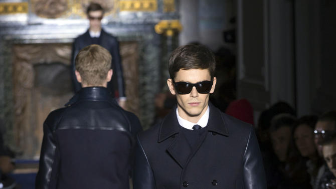 CORRECTS DAY TO WEDNESDAY Models wear creations by fashion designers Maria Grazia Chiuri and Pier Paolo Piccioli for Valentino, as part of their presentation for the men's Spring Summer 2013 Haute Couture fashion collection presented in Paris, Wednesday, Jan. 16, 2013. (AP Photo/ Jacques Brinon)