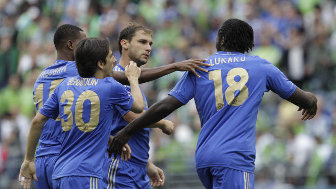 Chelsea's Romelu Lukaku (18) is greeted by teammates Nathaniel Chalobah, left, Yossi Benayoun (30) and Branislav Ivanovic after he scored against the Seattle Sounders in the first half of an exhibition soccer match, Wednesday, July 18, 2012, in Seattle. (AP Photo/Ted S. Warren)
