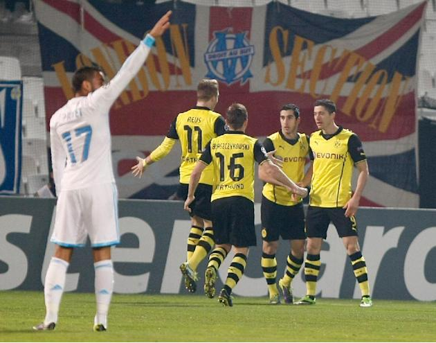 Dortmund's Robert Lewandowski, right, celebrates his opening goal with teammates during the Group F Champions League soccer match between Olympique Marseille and Borussia Dortmund at the Velodrome
