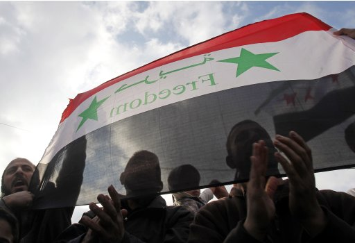 Syrians living in Jordan shout slogans against Syrian President Bashar al-Assad after morning prayers on the first day of Eid al-Adha outside the Syrian embassy in Amman