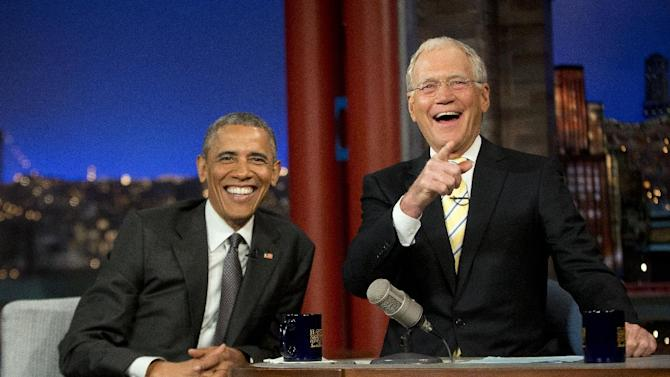 "President Barack Obama with host David Letterman smile during a break at a taping of CBS The Late Show with David Letterman at the Ed Sullivan Theater in New York, Monday, May 4, 2015. Obama traveled to New York to announced the creation of an independent nonprofit organization that is a spinoff his ""My Brother's Keeper"" program, to tape a segment on Letterman's show and to do fundraising for the Democratic party. (AP Photo/Pablo Martinez Monsivais)"
