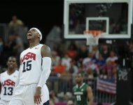 USA's Carmelo Anthony laughs after hitting a 3-pointer against Nigeria during a men's basketball game at the 2012 Summer Olympics, Thursday, Aug. 2, 2012, in London. (AP Photo/Charles Krupa)