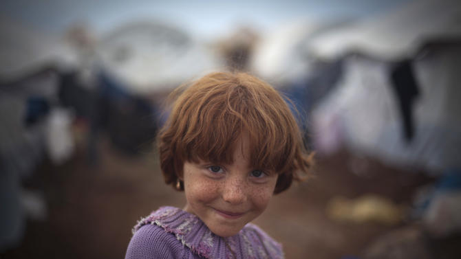 Sidra Ali, 5, who fled with her family from the violence in their village, poses for a photograph in the Syrian village of Atmeh, near the Turkish border with Syria,Thursday, Nov. 8, 2012.(AP Photo/ Khalil Hamra)