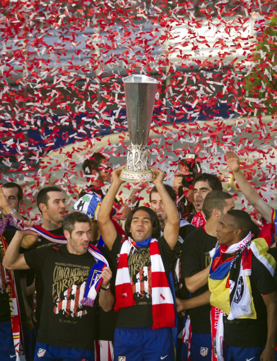 Atletico Madrid's Colombian Radamel Falcao (C), Atletico Madrid's Captain Antonio Lopez (L) And Colombian Luis Perea (R) AFP/Getty Images