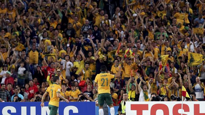 Australia's Massimo Luongo celebrates in front of fans after scoring a goal against South Korea during their Asian Cup final soccer match at the Stadium Australia in Sydney