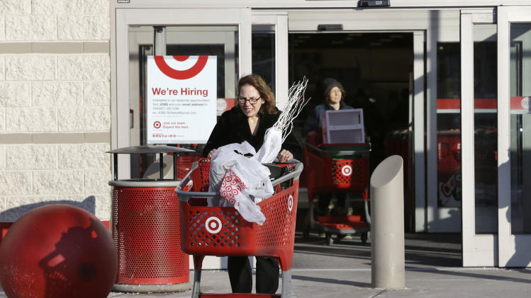 Customers push shopping carts as they depart a Target retail store Thursday, Dec. 19, 2013 in Watertown, Mass. Target says that about 40 million credit and debit card accounts may have been affected by a data breach that occurred just as the holiday shopping season shifted into high gear. (AP Photo/Steven Senne)