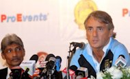 Manager of Manchester City Roberto Mancini (R) speaks while Malaysia national coach K. Rajagopal looks on during a press conference at the Palace of Golden Horses in Seri Kembangan. Mancini said that the English Premier League champions could have news on new players in the next fortnight