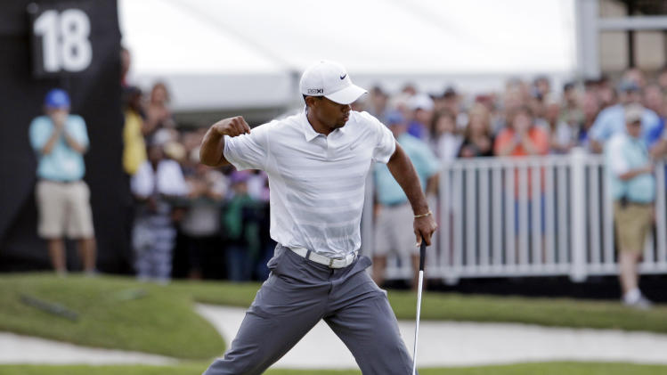 Tiger Woods pumps his fist after making birdie putt on the 18th hole during the third round of the Cadillac Championship golf tournament Saturday, March 9, 2013, in Doral, Fla. (AP Photo/Alan Diaz)