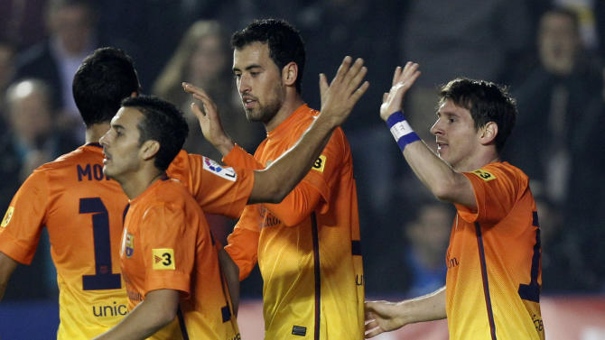 Barcelona's Lionel Messi from Argentina, right, is congratulated by teammate after scoring a goal against Levante during their la liga soccer match at the Ciutat Valencia stadium in Valencia, Spain, Sunday, Nov. 25, 2012.(AP Photo/ Alberto Saiz)