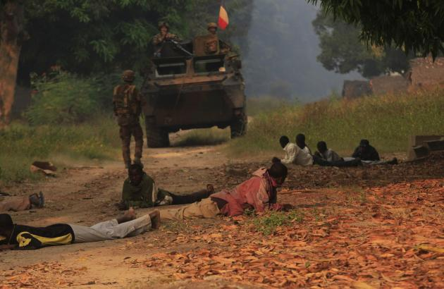 Residents lie on the ground as they are searched by French soldiers during their patrol the villages in Bossangoa, north of the CAR capital Bangui