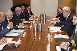 US Secretary of State John Kerry, second right, meets …