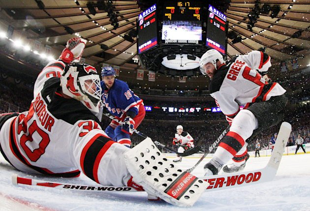 Martin Brodeur #30 And Andy Greene #6 Of The New Jersey Devils Defend Against The New York Rangers In Game One Of The Getty Images
