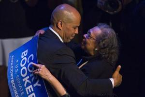 U.S. Senate candidate Cory Booker hugs his mother Carolyn after delivering a speech during his campaign's election night event in Newark, New Jersey