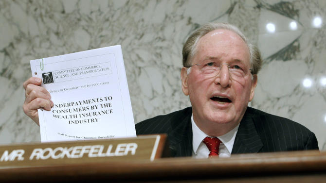 FILE - In this Sept. 29, 2009, file photo Senate Finance Committee member Sen. Jay Rockefeller, D-W.Va., holds up a report about underpayment to consumers during the markup of health care legislation on Capitol Hill in Washington. U.S. Sen. Jay Rockefeller said Friday, Jan. 11, 2012, that he will not seek a sixth term in 2014, a half-century after he emerged from one of America's most recognizable dynasties to land in West Virginia and climb atop its political ranks. (AP Photo/Susan Walsh, File)