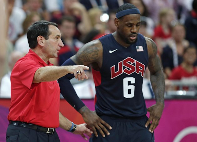 USA coach Mike Krzyzewski talks with LeBron James during a men&#39;s basketball game against Lithuania at the 2012 Summer Olympics, Saturday, Aug. 4, 2012, in London. (AP Photo/Charles Krupa)
