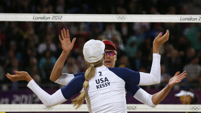 Ross and Kessy of the U.S. celebrate a point against Brazil's Juliana and Larissa during their women's beach volleyball semifinal match at Horse Guards Parade during the London 2012 Olympic Games