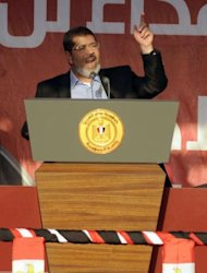 Egypt's Islamist president-elect Mohamed Morsi addresses tens of thousands of Egyptians in Cairo's iconic Tahrir Square. Morsi paid tribute to Egypt's Muslims and Christians alike and symbolically swore himself in as the country's first elected civilian president
