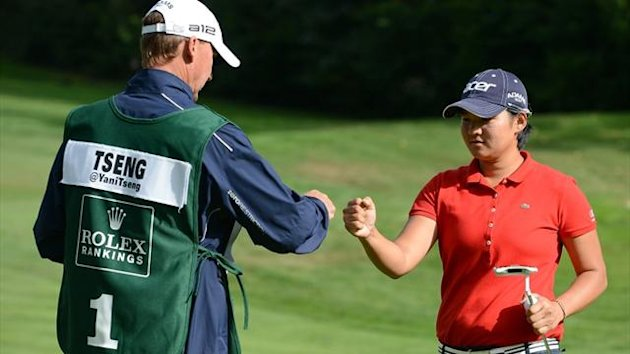Yani Tseng celebrates her birdie with her caddie on the sixth hole on way to a six under 66 to lead the tournament during round one of the Canadian Women's Open at The Vancouver Golf Club (AFP)