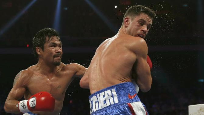 Pacquiao of the Philippines punches Algieri of the U.S. during their WBO 12-round welterweight title fight in Macau
