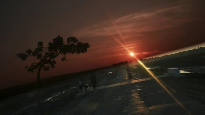 The sun sets behind a road that was built by the government for better connection between Rakhine ethnic villages outside Maungdaw town in northern Rakhine State