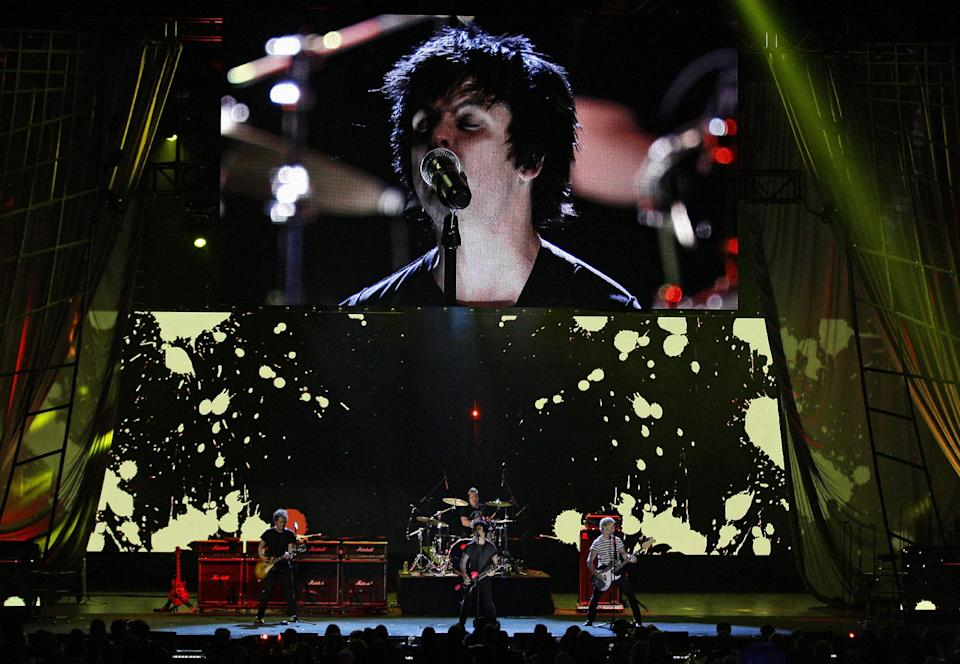 Green Day performs to open the 2012 Rock and Roll Hall of Fame induction ceremonies Saturday, April 14, 2012, in Cleveland. Green Day introduce Guns N' Roses for induction into the Rock and Roll Hall of Fame. (AP Photo/Tony Dejak)