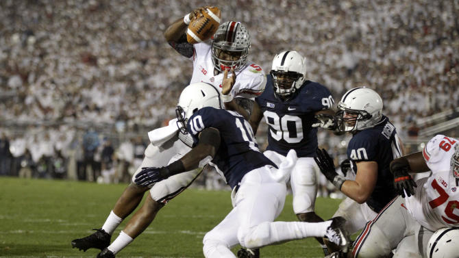 Ohio State quarterback Braxton Miller (5) dives over Penn State safety Malcolm Willis (10) for a touchdown during the third quarter of an NCAA college football game in State College, Pa., Saturday, Oct. 27, 2012. (AP Photo/Gene J. Puskar)