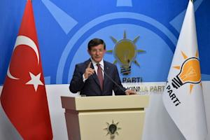 Turkey's Prime Minister Davutoglu speaks during a news conference at his ruling AK Party headquarters in Ankara, Turkey