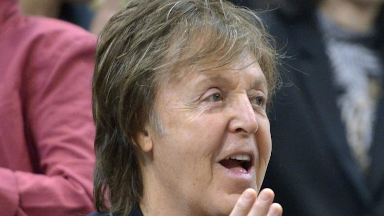 Paul McCartney watches a sumo match on the fifth day of the Kyushu Grand Sumo Tournament, in Fukuoka, western Japan, Thursday, Nov. 14, 2013. In an open letter posted on McCartney's official website Thursday, McCartney urges Russian President Vladimir Putin to help secure the release of Greenpeace activists who were detained during a protest at a Russian oil rig in the Arctic on Sept. 18, 2013 and are being held in Russia. (AP Photo/Kyodo News) JAPAN OUT, MANDATORY CREDIT
