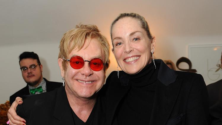 "IMAGE DISTRIBUTED FOR LOVEGOLD - Sharon Stone, right, and Elton John attend LoveGold/EJAF Celebrate ""How to Survive a Plague"" at Chateau Marmont on February 22, 2013 in Los Angeles. (Photo by Jordan Strauss/Invision for LoveGold/AP Images)"
