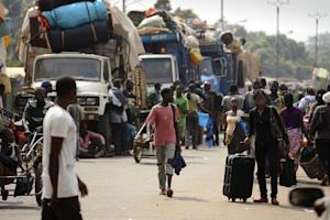 Muslim civilians prepare to board trucks in Bangui …
