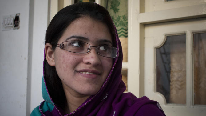 In this Wednesday, Nov. 14, 2012 photo, Pakistani girl Kainat Riaz, 16, is seen at her home in Mingora, Swat Valley, Pakistan, after being wounded by the same Taliban gunman, who shot Malala Yousufzai and 13-year-old Shazia Ramazan, Oct 8, 2012 on their way coming back from school. Malala was shot for her outspoken insistence on girls education. Shazia and Kainat are to return to school this week for the first time since the shooting more than one month ago. ( AP Photo/Anja Niedringhaus)