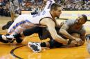 Phoenix Suns Marcus Morris tries to call time out as Oklahoma City Thunder Mitch McGary battles for the ball during the first half of an NBA basketball game, Thursday, Feb. 26, 2015, in Phoenix. (AP Photo/Matt York)