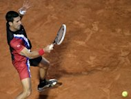 Serbia's Novak Djokovic returns a ball to Swiss Roger Federer during their semi-finals match of the ATP Rome tournament. Djokovic ended Federer's brilliant run of recent clay form, defeating the world number two, and last week's Madrid champion, 6-2, 7-6 (7/4)