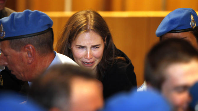 FILE - In this Oct. 3, 2011 file photo Amanda Knox cries after hearing the verdict that overturned her conviction and acquitted her of murdering her British roommate Meredith Kercher, at the Perugia court, central Italy.  Italy's highest criminal court has overturned the acquittal of Amanda Knox in the slaying of her British roommate and ordered a new trial. The Court of Cassation ruled Tuesday, March 26, 2013 that an appeals court in Florence must re-hear the case against the American and her Italian-ex-boyfriend for the murder of 21-year-old Meredith Kercher. (AP Photo/Pier Paolo Cito, file)