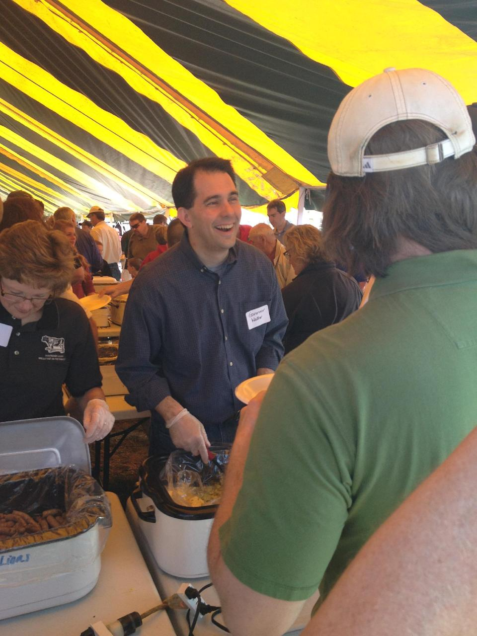 Republican Gov. Scott Walker, who will try to defend his seat from Democratic challenger Tom Barrett  in Wisconsin's recall election Tuesday, serves eggs at a dairy breakfast in the Town of Rockland, Wis., on Sunday, June 3, 2012. (AP Photo/Roger Schneider)