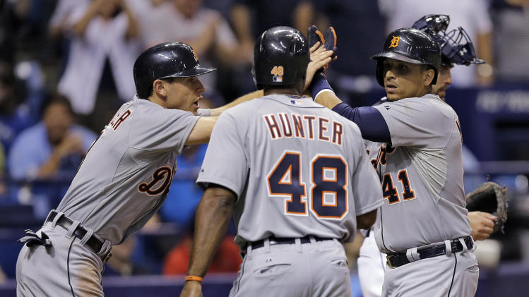 Detroit Tigers' Victor Martinez (41) celebrates with teammates Ian Kinsler (3) and Torii Hunter (48) after hitting a grand slam off Tampa Bay Rays starting pitcher Jake Odorizzi during the seventh inning of a baseball game Wednesday, Aug. 20, 2014, in St. Petersburg, Fla. (AP Photo/Chris O'Meara)