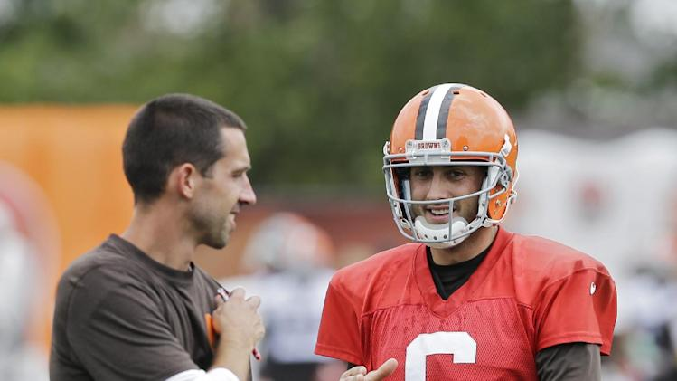 Cleveland Browns quarterback Brian Hoyer (6) talks to offensive coordinator Kyle Shanahan during practice at the NFL football team's facility in Berea, Ohio Wednesday, Aug. 20, 2014. Earlier Hoyer was named the regular season starter by head coach Mike Pettine