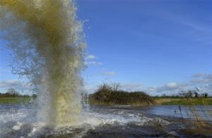 An emergency flood pump ejects water into the River Parrett near the village of Moorland in south west England