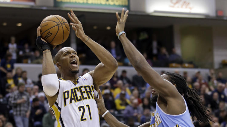 Indiana Pacers forward David West (21) shoots over Denver Nuggets forward Kenneth Faried in the second half of an NBA basketball game in Indianapolis, Monday, Feb. 10, 2014. The Pacers defeated the Nuggets 119-80. (AP Photo/Michael Conroy)
