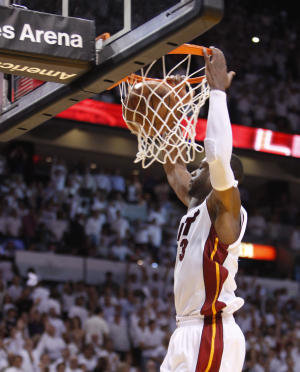 Miami Heat's Dwyane Wade dunks the ball during the final seconds of Game 5 of a first-round NBA playoff basketball series against the Philadelphia 76ers, Wednesday, April 27, 2011, in Miami. Wade scored 26 points as the Heat defeated the 76ers 97-91 to advance to Eastern Conference semifinals. (AP Photo/Wilfredo Lee)