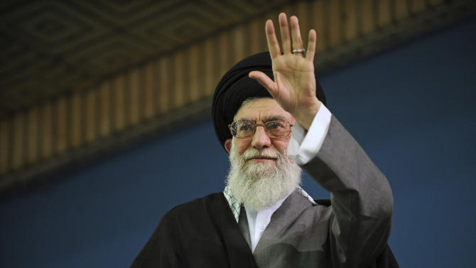 In this Saturday, Feb. 16, 2013 photo released by the official website of the Iranian supreme leader's office, Supreme Leader Ayatollah Ali Khamenei waves to a crowd attending his speech in a mosque inside the leader's housing compound in Tehran, Iran. Ayatollah Ali Khamenei has adopted the role of political referee as the political mudslinging gets heavier ahead of elections in June to pick a successor for President Mahmoud Ahmadinejad. (AP Photo/Office of the Supreme Leader)