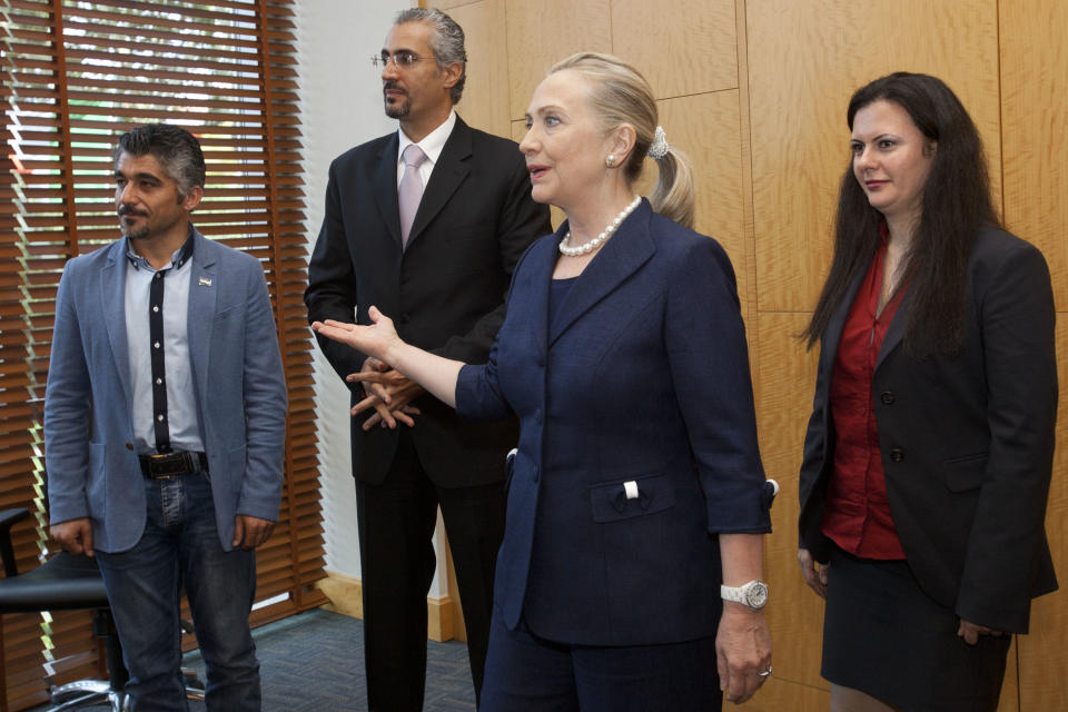 U.S. Secretary of State Hillary Rodham Clinton, second from right, meets with Syrian activists, in Istanbul, on Saturday, Aug. 11, 2012. (AP Photo/Jacquelyn Martin, Pool)