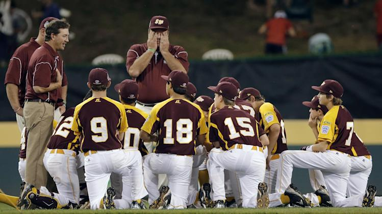 San Antonio players and coaches gather after losing a baseball game against Petaluma, Calif., at the Little League World Series, Thursday, Aug. 23, 2012, in South Williamsport, Pa. California won 11-1. (AP Photo/Matt Slocum)