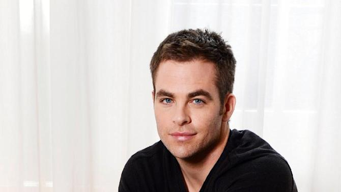 "This Wednesday Sept. 19, 2012 photo shows Chris Pine posing for a portrait session at Claridges, in London. As a kid, Chris Pine used to be afraid of the bogeyman. Now he fights one on the big screen.  The 32-year-old American actor is taking on his first voice-over role as Jack Frost in Dreamworks animated film ""Rise of the Guardians."" His winter wonderland character is asked to join Santa, the Easter Bunny and the Tooth Fairy _ played by Alec Baldwin, Hugh Jackman and Isla Fisher _ to defeat a bogeyman called Pitch (Jude Law). Pine says the most magical part is getting to see his vocals combined with the animators' work.   (Photo by Jon Furniss/Invision/AP)"
