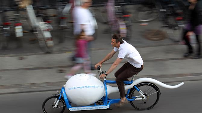 "In this undated photo is the spermbike ' Spermbullit ' is seen on the streets of Copenhagen, Denmark. European cities promote cycling with everything from 'superhighways' to revolving bike racks.  More and more companies use custom-made bikes to carry packages of particular shapes and sizes. Some are designed to serve as billboards for companies, like the ""sperm bike"" used by a Danish sperm bank to transport sperm to fertility clinics in Copenhagen.(AP Photo/European Sperm Bank/POLFOTO/handout)"