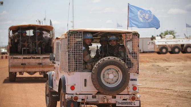 "In this photo taken Tuesday, May 24, 2011 and released May 25 by the United Nations Mission in Sudan (UNMIS), the first of 125 Indian soldiers serving with the international peacekeeping force arrive in Abyei, Sudan. Gunmen from an Arab tribe fired on four U.N. helicopters taking off from Abyei, a disputed north-south Sudan border town, an official said Wednesday, May 25, 2011, while Sudan's president gave northern troops a ""green light"" to attack southern forces if provoked. (AP Photo/UNMIS, Stuart Price) EDITORIAL USE ONLY, NO SALES"