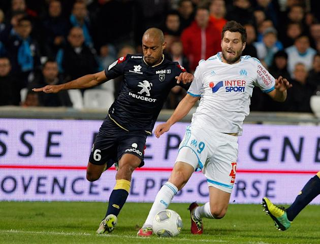 Marseille's forward Andre-Pierre Gignac, right, challenges for the ball with Sochaux's Malian defender Cedric Kante, during their League One soccer match, at the Velodrome Stadium, in Marseille, south