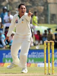 Pakistan bowler Saeed Ajmal celebrates the dismissal of Sri Lankan batsman Tharanga Paranavitana during the third day of the opening Test Match between Sri Lanka and Pakistan in Galle. Sri Lanka turned the screws on Pakistan in the first Test in Galle after battering the tourists with both bat and ball on the third day