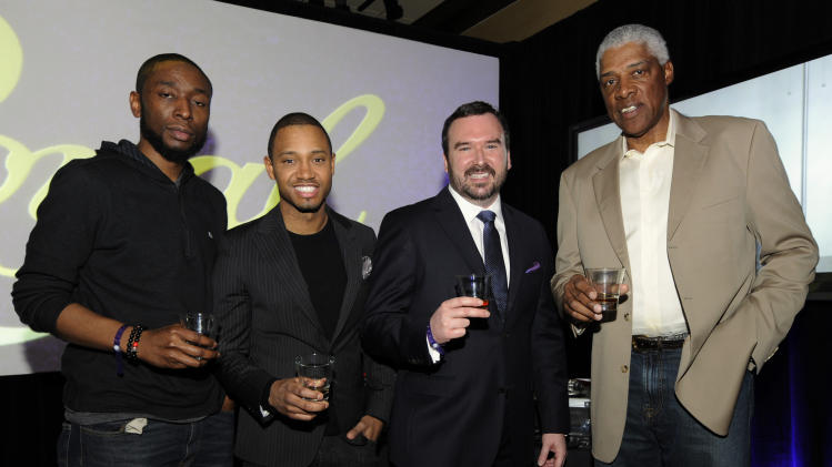 IMAGE DISTRIBUTED FOR CROWN ROYAL - Hip Hop producer 9th Wonder, left, Terrence J, Master of Whisky Stephen Wilson, and basketball legend Dr. J pose for a photo at the Crown Royal Reign On launch party during All-Star weekend on Saturday, Feb. 16, 2013, in Houston. Reign On is Crown Royal's new advertising campaign released this week. (Photo by Jack Dempsey/Invision for Crown Royal/AP Images)