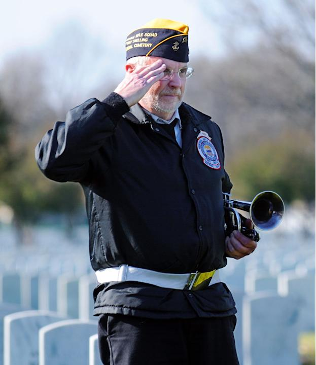 ** ADVANCE FOR USE ON THURSDAY, NOV. 11, 2010 AND THEREAFTER ** In this Tuesday Nov. 2, 2010 picture, Jim McGee, a member of the Fort Snelling Memorial Rifle Squad, salutes during a veteran's funeral